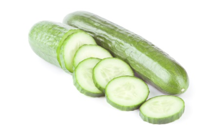 fresh cucumbers over white background