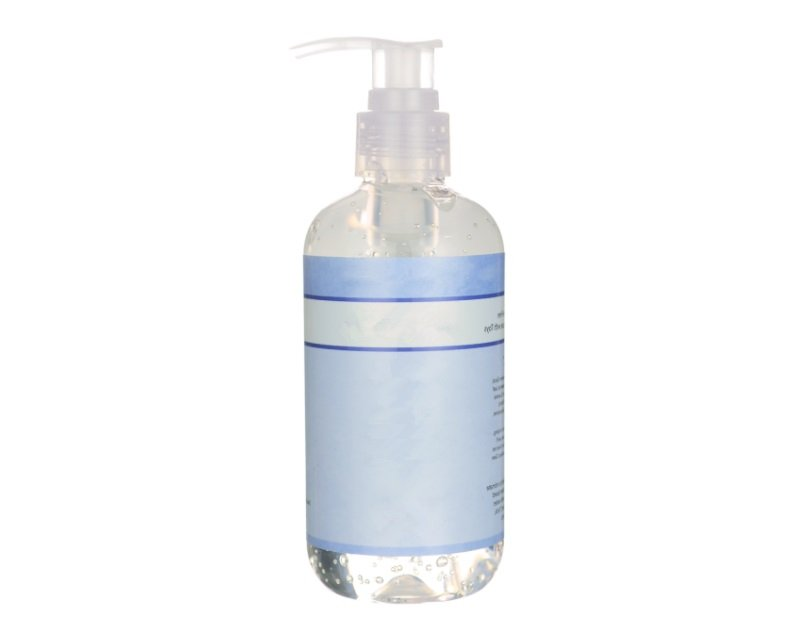 Clear bottle of silicone-based lube with white background