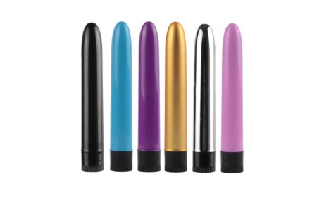 six plastic vibrators of various colors over white background